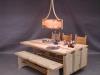 Gästabudsbord med storkstolar och bänk.